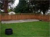 Panel fencing with trellis top designed and installed by cambridge fencing and decking.