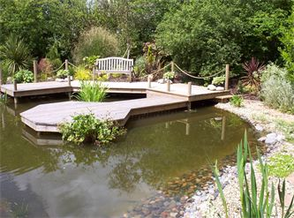 Wooden decking and jetty designed and installed by cambridge fencing and decking.